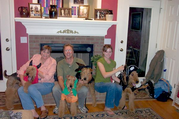 family with airedales at halloween