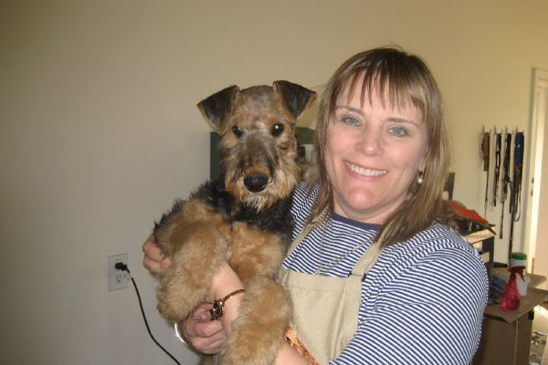 holding an airedale puppy
